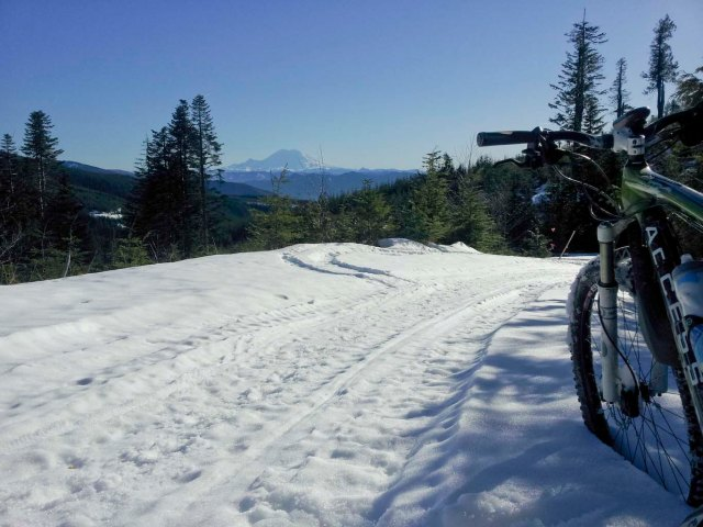 Pushing my bike up some unnamed hill top - always good to turn around and see what might be in view: here Mt. Rainier.